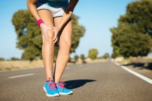 Female runner knee injury and pain.